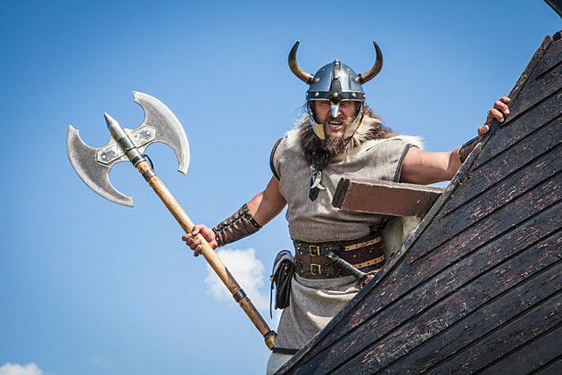 Strong angry Viking on his ship